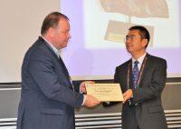 Photo of Binnemans receiving the LeCoq award